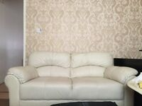 Cream leather , three and two sofa in excellent condition