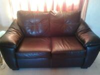 black leather matching couch and love seat