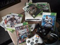 Xbox 360 console 60g, including 3 wireless controllers and a wireless network adapter 8 games