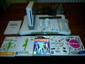 Wii console + balance board + games
