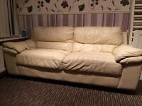 Cream leather sofa and two chairs