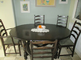 Ercol oval dining room table (extendable) and six cushioned Ercol Chairs.