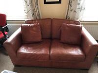 Two seater Leather Sofa second hand