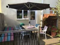 Garden table and chairs with large umbrella