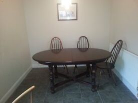 Beautiful Oval Extending Dark Oak Ercol Table with Six Ercol Chairs