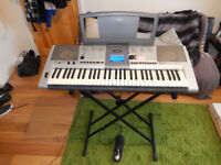 Yamaha PSR E403 Keyboard with stand, power cable, and sustain peddle
