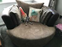 New swivel cuddle chair with moon shaped footstool