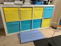 IKEA kallax unit with coloured insert box drawers