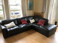 Large black leather sofa / sofabed