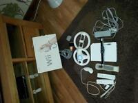 Nintendo Wii, 2 controllers, 1 nunchuck, 2 steering wheels & 10 games