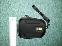 Case Logic camera belt case.