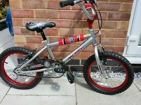 Boys red and silver bike. ideal bike for age 5+. excellent condition. includes blue helmet.