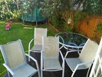 Garden table and four chairs, glass and metal