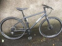 Pinnacle lithium hybrid bike, excellent condition, new shwalbe puncture proof tyres.