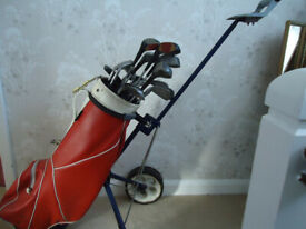 Golf trolley and collection of clubs