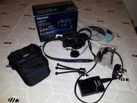 Panasonic Lumix LX-7 with tripod and pouch