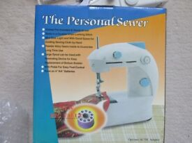 Mini Sewing Machine and many Accessories, brand new and unused, battery or mains operated