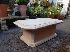 Coffee table with sliding marble panels