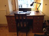 Oak desk double pedestal leather top brass handles 9 drawers