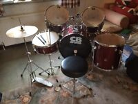 CB Drum Kit with 2 sets of drumsticks, red and in good condition.