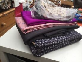 Small bundle of vintage fabric and old fabric for crafting.