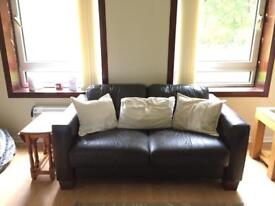 2 x identical brown leather sofas