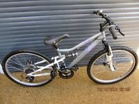 CHILDS APOLLO SUSPENSION BIKE WITH DUAL DISC BRAKES IN ALMOST NEW CONDITION.. (SUIT APROX. AGE. 9+).