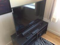 """50"""" LED BUSH 4K Ultra HD TV + Sony Sound System + TV Stand"""
