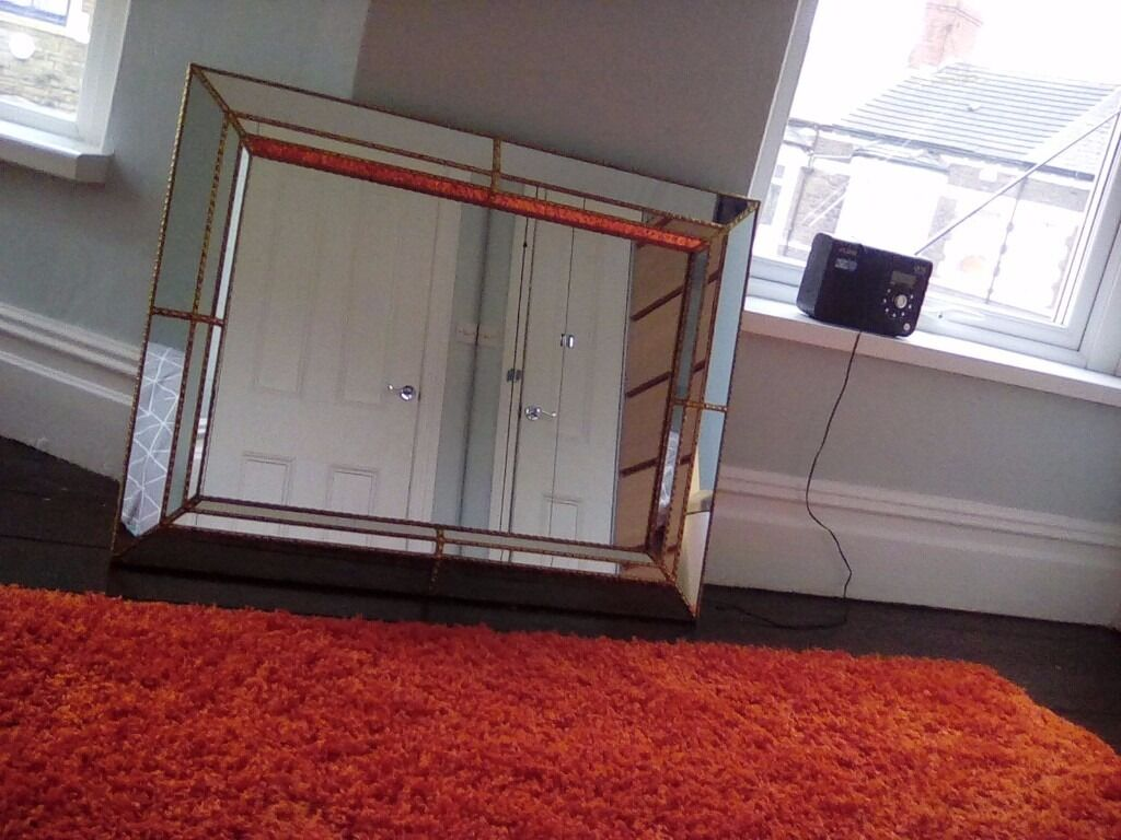 """Ornate mirrorin Canton, CardiffGumtree - Ornate mirror. Inlaid with mirror tiles and gold metal strips. Solid piece. Date stamped June 1987. In very good condition. Eyecatching design. 34.5"""" x 26.5"""" approx 88cm x 68cm approx"""