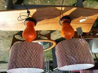 A pair of genuine 1960's orange table lamps with brand new hand made lamp shades