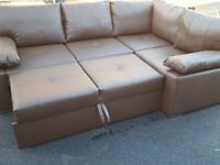 Lovely Brand New corner sofa bed with storage. brown faux leather. delivery available