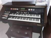 Hammond xh 200 s.p with Leslie speaker 215 with seat and books all v.g.c .