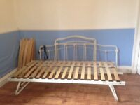 £50. Ono. Day bed frame with pull out spare bed that stores underneath. No mattresses included.