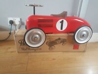Red racing car used once for cake smash photos