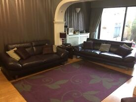 3 & 2 piece sofas excellent condition aubergine in colour leather Italian.