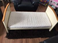 Free Toddlers bed with clean mattress.