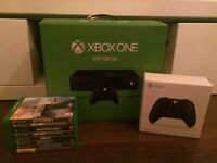 xbox one console boxed, 2 x controllers & 8 games