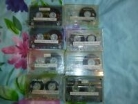 8 grimy tapes with brand new covers