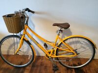 Ladies yellow bike with basket for sale