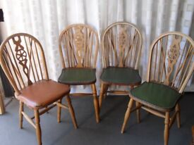 SET OF FOUR ERCOL STYLE WHEEL BACK DINING CHAIRS WITH FAUX LEATHER SEAT COVERING FOR UPCYCLE.