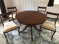 Regency extendable table and four chairs.