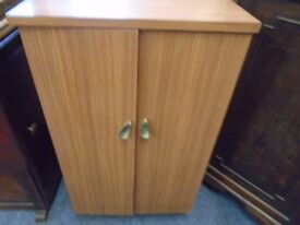 small cabinet with storage compartments.