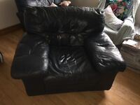 2 Blue leather arm chairs