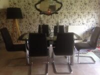 Glass table & 6 black leather chairs