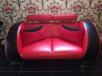 Red and black leather sofa