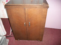 Singer electric sewing machine in cabinet. Vintage.