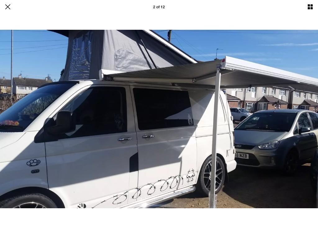 VW T5 camper van with wind out awning and pop up roof plus ...
