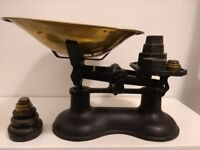 Vintage-style black kitchen weighing scales and weights