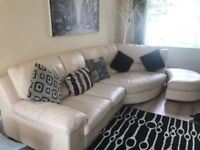 Corner Ivory leather settee for sale