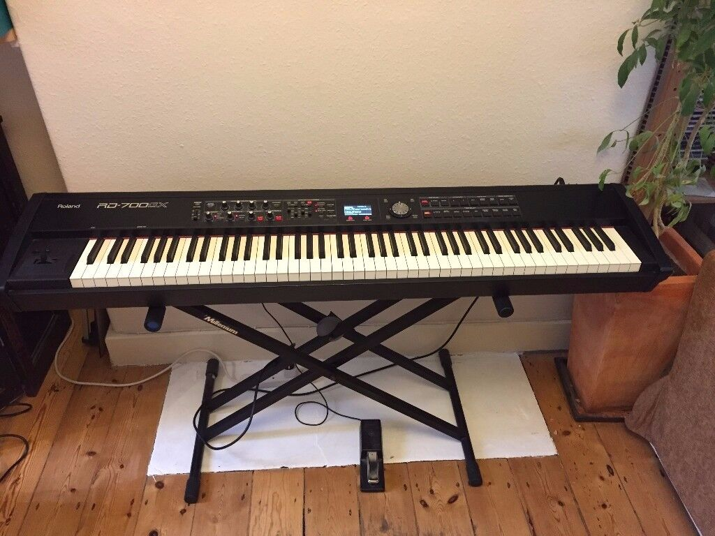 Roland RD-700GX stage piano, sustain pedal, stand and hard case